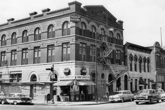The Tremont Hotel as it appeared on May 26, 1956. At the time this photo was taken, it was considered the oldest hotel in operation in Houston's history. Opened in 1903, the 50-room hotel was located at the northwest corner of Milam and Congress.   The building was opened by Otto Sens Sr. Meals and rooms were $1.50 a day. No private bathrooms and only four rooms had closets. The first fan wasn't even installed until 1948.   The Hogg family bought a lease on the site from Sens' heirs and gifted it over to the University of Texas sometime in the 1950s. The hotel was torn down in 1956. In the 1970s, Look's Depot was on this block. Today, a Chase Motor Bank occupies the site.