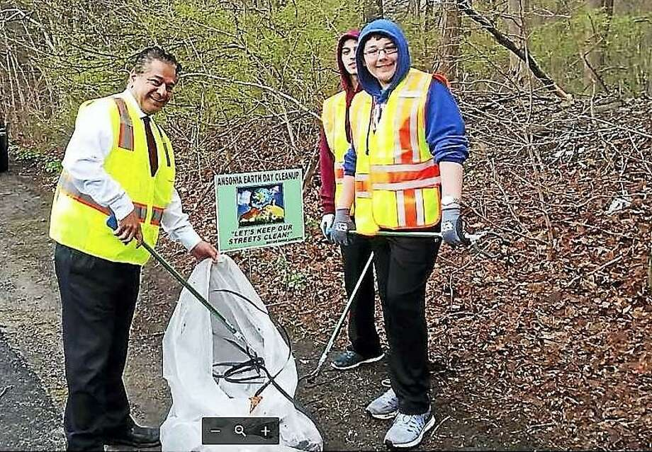 Mayor David Cassetti and two student volunteers during Ansonia's 2017 Earth Day Community Clean-Up. Photo: Greg Martin /Ansonia City Hall /