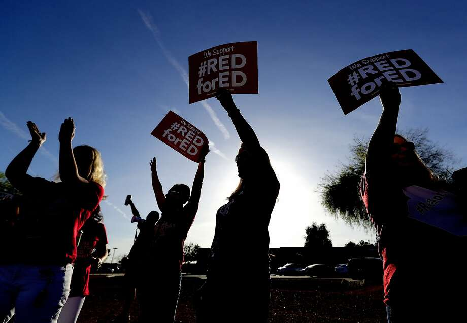Teachers at Humphrey Elementary school protest prior to classes in Chandler, Ariz. Teachers are demanding a 20 percent pay raise and $1 billion in new education funding. Photo: Matt York / Associated Press