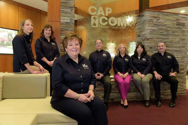 Paula Stopera, foreground, President and CEO of CapCom, poses with employees, from left to right, Theresa Trietiak, Director of Human Resources, Amanda Goyer, Community Relations Manager, John Shartrand, Chief Investment Officer, Kate Fruscione, Public Relations Strategist, Sharon Phillips, VP Organizational Development, and Chris McKenna, Executive Vice President and Chief Lending Officer, at CapCom Headquarters on Tuesday, March 13, 2018, in Colonie, N.Y.    (Paul Buckowski/Times Union)