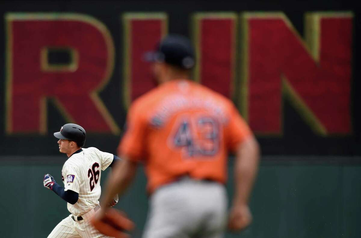 MINNEAPOLIS, MN - APRIL 11: Lance McCullers Jr. #43 of the Houston Astros looks on as Max Kepler #26 of the Minnesota Twins rounds the bases after hitting a two-run home run during the fourth inning of the game on April 11, 2018 at Target Field in Minneapolis, Minnesota.