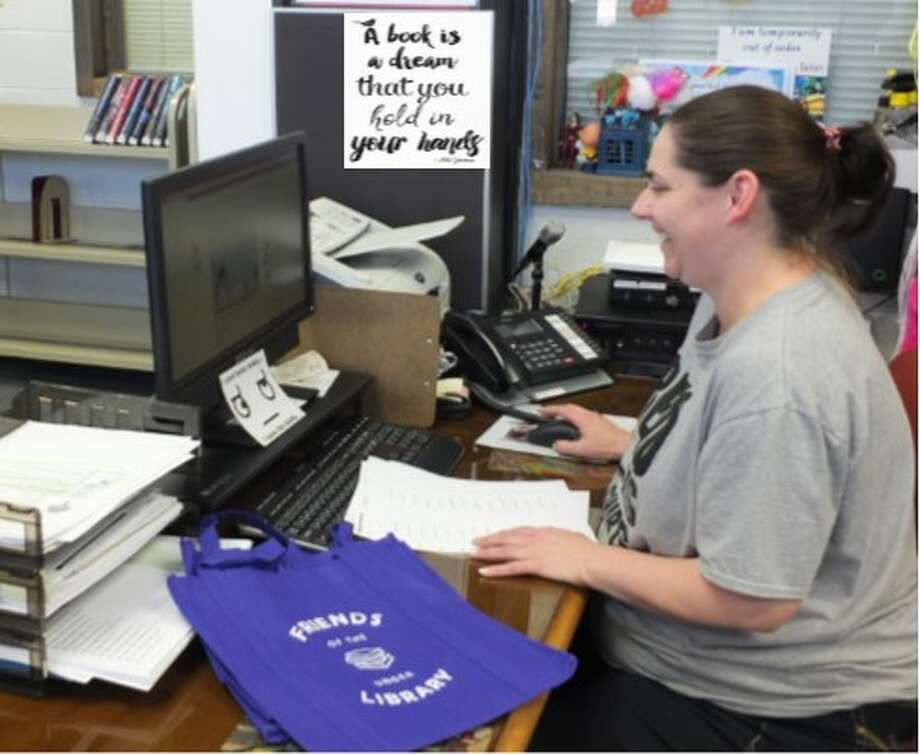 Rebecca Hall, Library Aide at Unger Memorial Library, helps prepare items for contests taking place at the library during National Library Week.   Photo: Courtesy Photo