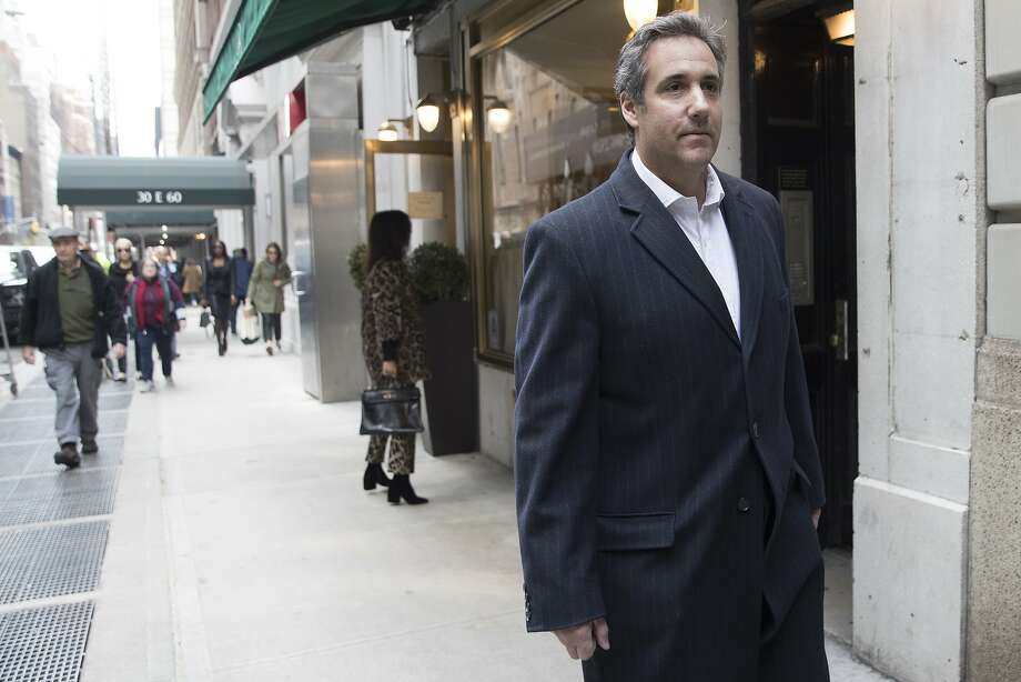Attorney Michael Cohen walks down the sidewalk, Wednesday, April 11, 2018, in New York. Federal agents who raided the office of President Donald Trump's personal attorney, were looking for information about payments to a former Playboy playmate and a porn actress who claim to have had affairs with Trump, two people familiar with the investigation said. (AP Photo/Mary Altaffer) Photo: Mary Altaffer / Associated Press