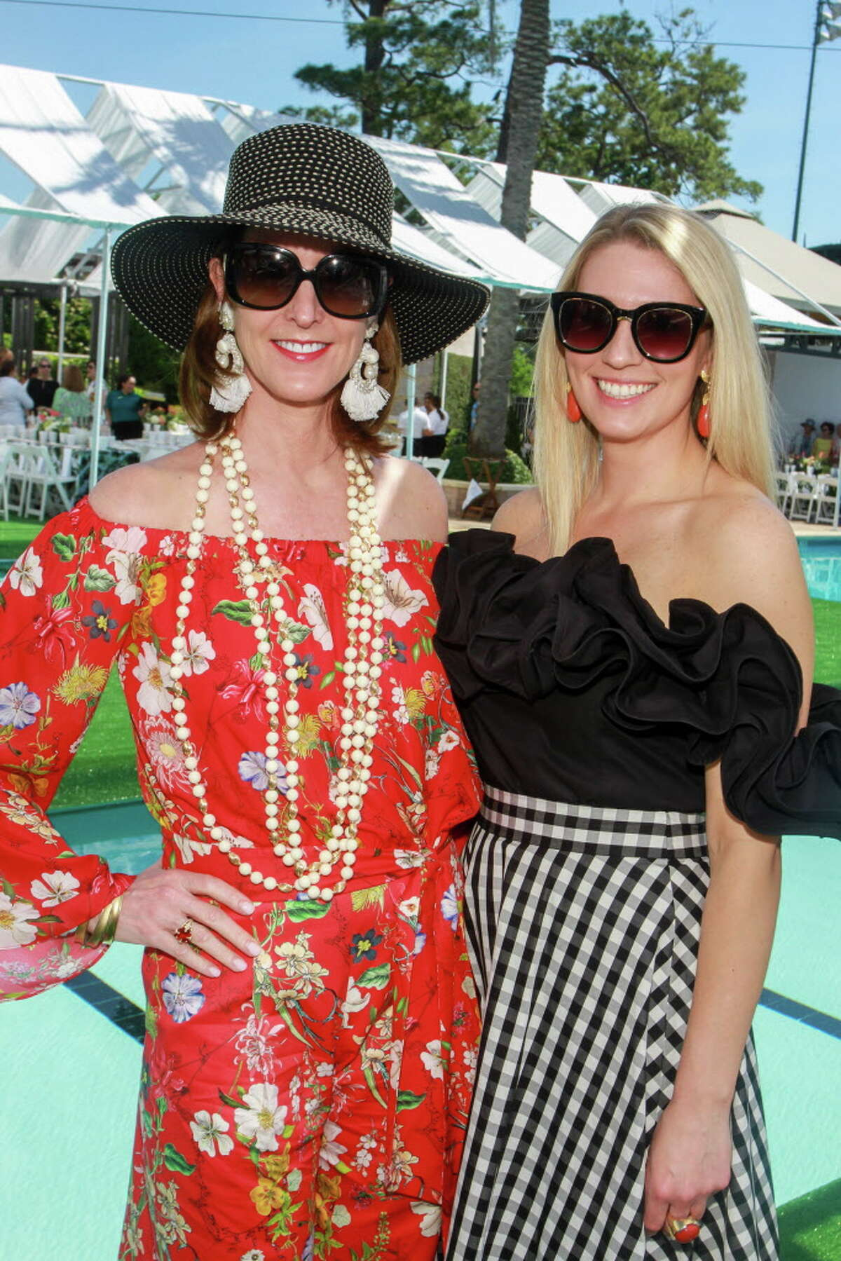 Phoebe Tudor, left, and Christina Stith at the Clay Court Tennis Fashion Show luncheon at River Oaks Country Club.