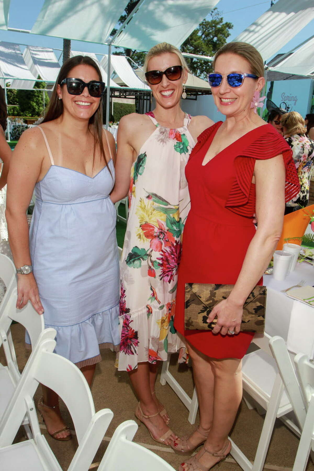 Lauren Morgan, from left, Kristina Frankel and Sandy Sturm at the Clay Court Tennis Fashion Show luncheon at River Oaks Country Club.