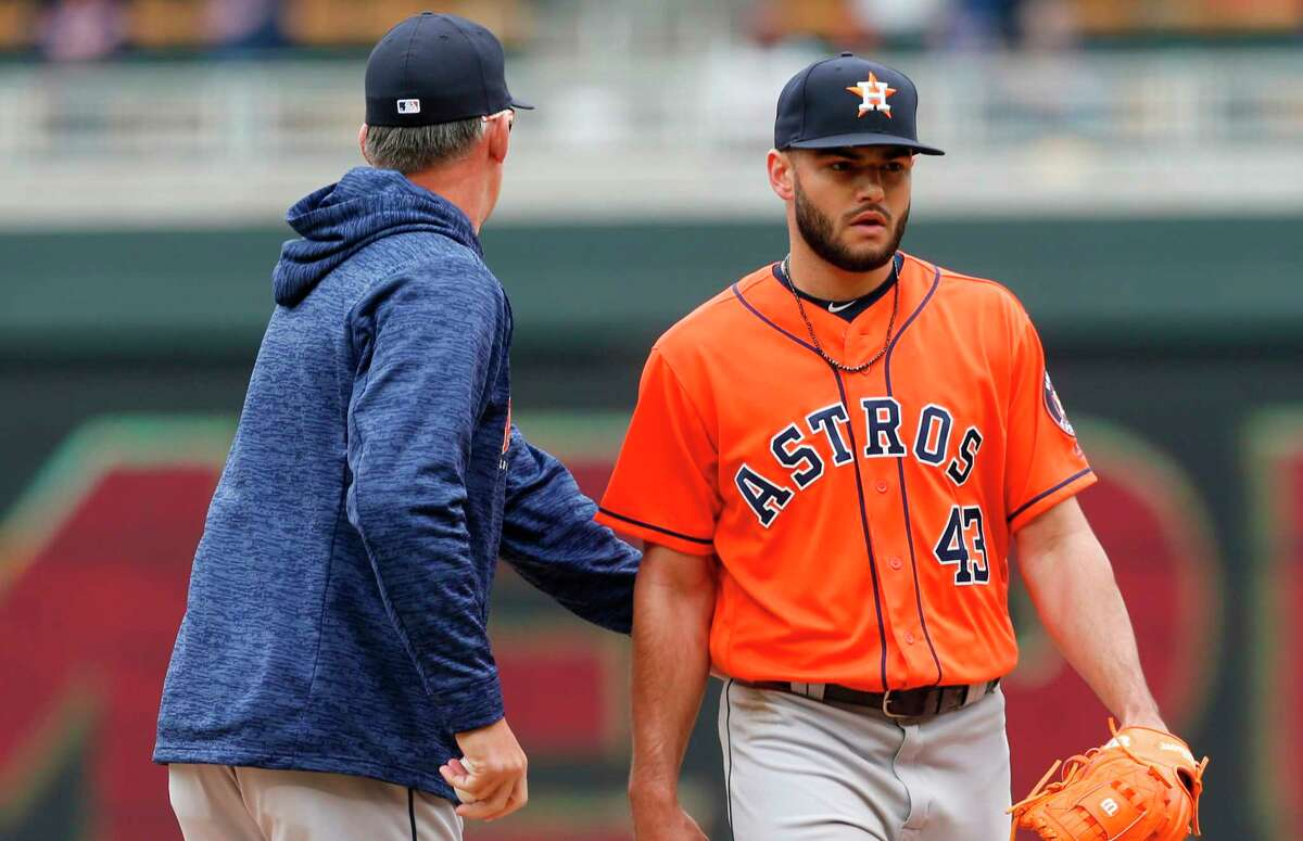 Houston Astros pitcher Lance McCullers Jr., right, gets a pat on the back from manager Al Hinch as he is pulled in the fourth inning of a baseball game after giving up a two-run home run to Minnesota Twins' Max Kepler Wednesday, April 11, 2018, in Minneapolis. (AP Photo/Jim Mone)