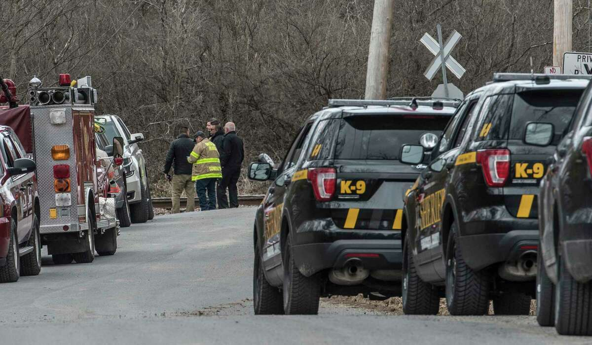 Representatives from Homeland Security, Saratoga County Sheriff Mike Zurlo and fire are scene near a line of law enforcement vehicles near where a device that looked like a pipe bomb was located near Zepko Road Wednesday April 11, 2018 in Ballston Spa, N.Y. (Skip Dickstein/Times Union)