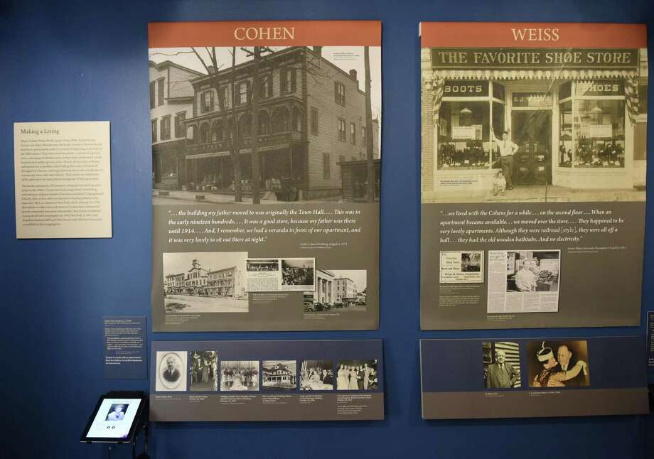 "Posters show information and photos regarding some of the first Jewish families to settle in Greenwich at the ""An American Odyssey: The Jewish Experience in Greenwich"" exhibit at the Greenwich Historical Society. The exhibition runs through Sunday. Photo: Tyler Sizemore / Hearst Connecticut Media / Greenwich Time"