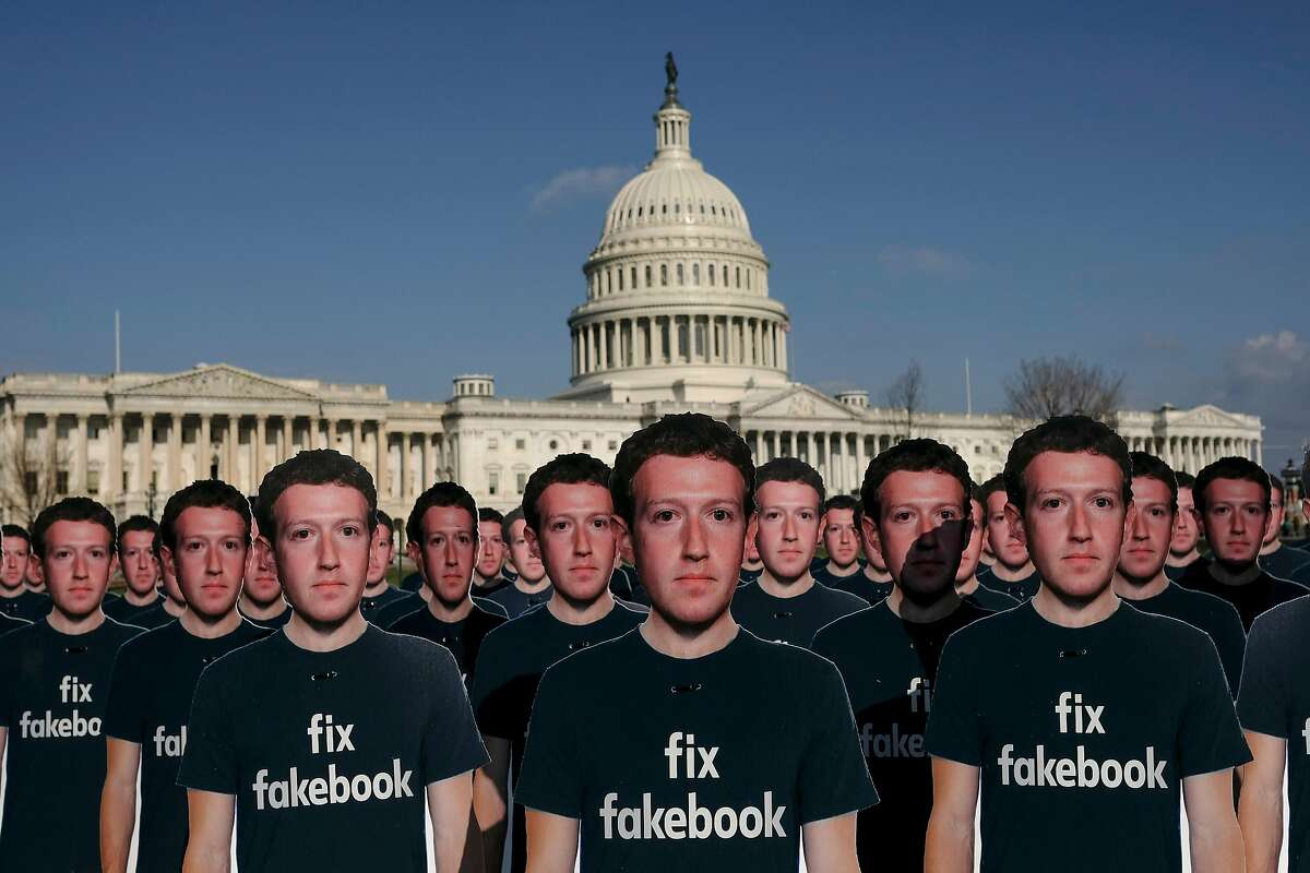 Cardboard cut outs of Mark Zuckerberg, Facebook�s chief executive, set out in front of the U.S. Capitol in Washington, April 10, 2018. Testifying before senators, Zuckerberg faced tough questions on Facebook's mishandling of data in a series of debacles over the past year. (Gabriella Demczuk/The New York Times)