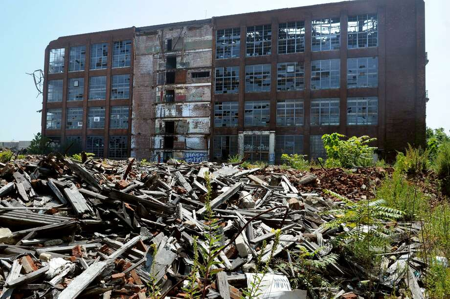 The former Remington Arms plant, in Bridgeport in 2014. Empty factories like this one, which is today owned by the city, have in years past been owned by a series of limited-liability corporations that made the job of deciphering ownership for the purposes of collecting back taxes an onerous task. Photo: Ned Gerard / File Photo / Connecticut Post