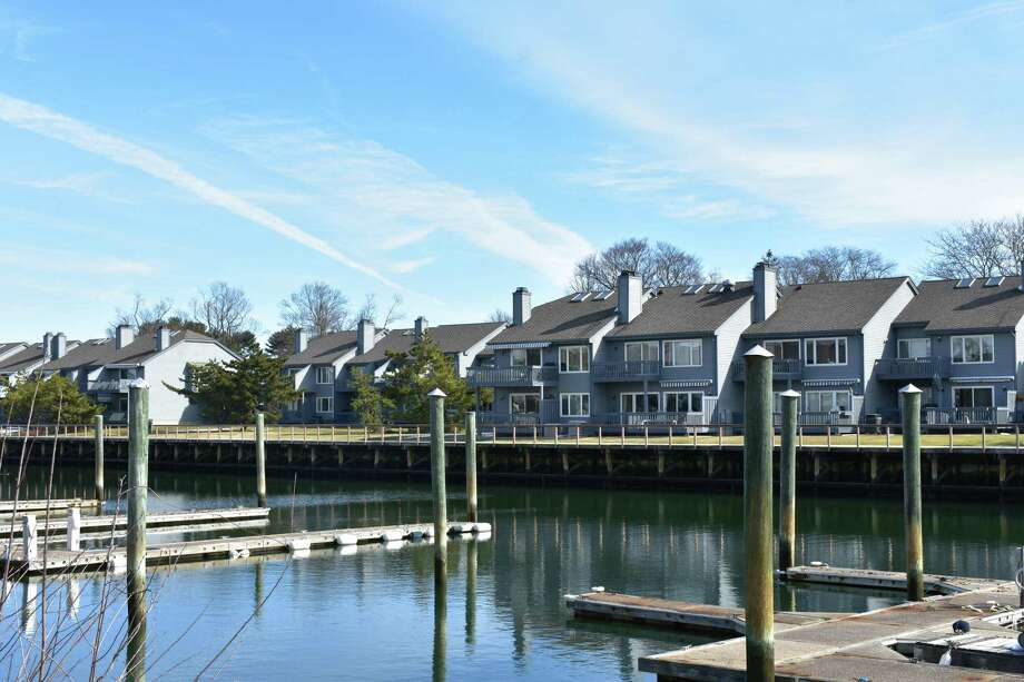 The Charles Cove condominiums in Norwalk, Conn., in March 2018. Condo sale listings were down in the first quarter of 2018 in Norwalk, running counter to listings of single-family homes which were up 11 percent. Photo: Alexander Soule / Hearst Connecticut Media / Stamford Advocate