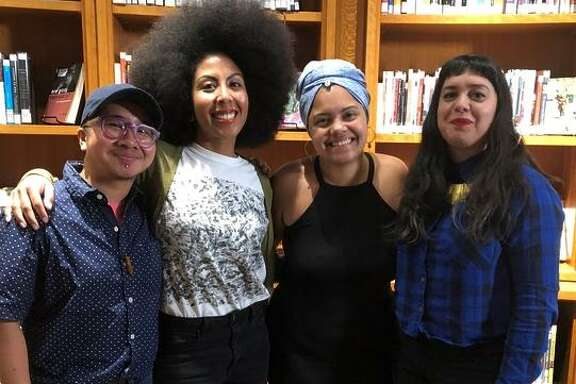 """Participants of the first 2018 'Show Us Your Spines' storytelling event talks to an audience at the San Francisco Main Library. The second event happens April 12."""""""