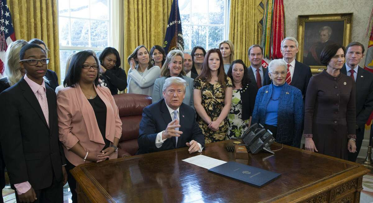 United States President Donald. J. Trump makes a statement before signing H.R. 1865, the