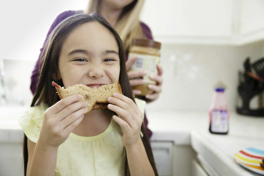 PHOTOS: 8 things you didn't know about peanut butter This stock image girl wisely eats her peanut butter and jelly sandwich at home instead of in a shopping cart at Target. Photo: Natalie Faye/Getty Images/Image Source