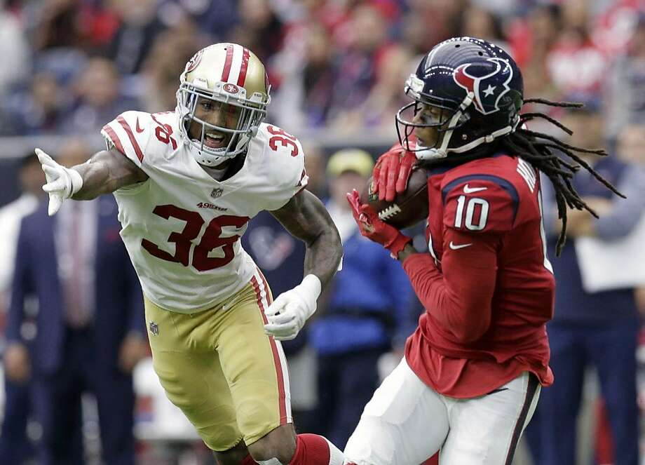 Houston Texans wide receiver DeAndre Hopkins (10) makes a catch in front of San Francisco 49ers cornerback Dontae Johnson (36) during the first half of an NFL football game, Sunday, Dec. 10, 2017, in Houston. (AP Photo/Michael Wyke) Photo: Michael Wyke / Associated Press