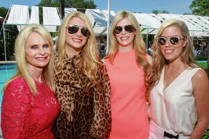 Jo Lynn Falgout, from left, Christine Falgout, Kimberly Falgout and Holly Alvis at the Clay Court Tennis Fashion Show luncheon at River Oaks Country Club.