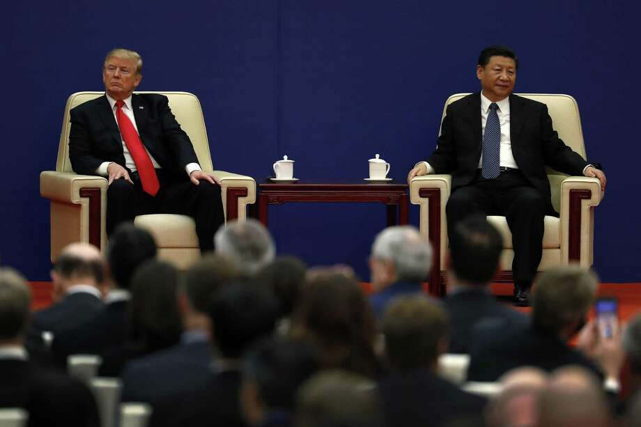 In this Nov. 9, 2017, photo, U.S. President Donald Trump, left, sits next to Chinese President Xi Jinping during a business event at the Great Hall of the People in Beijing. The brewing China-U.S. trade conflict features two leaders whove expressed friendship but are equally determined to pursue their nation's interests and their own political agendas. But while Trump faces continuing churn in his administration and a tough challenge in midterm congressional elections, Xi leads an outwardly stable authoritarian regime. Xi recently succeeded in pushing through a constitutional reform allowing him to rule for as long as he wishes while facing no serious electoral challenge.owing him to rule for as long as he wishes without facing serious electoral challenges. Photo: Andy Wong /Associated Press / Copyright 2018 The Associated Press. All rights reserved.