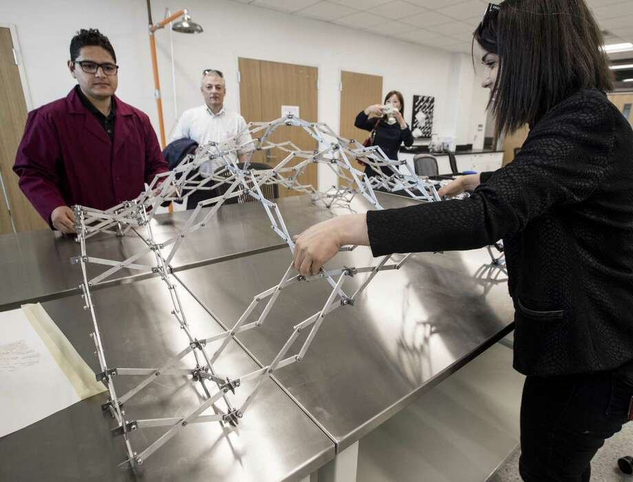 Abhinav Bhardwaj, Ph.D. student, left, and Dr. Nagar Kalantar, director of Advanced Infastructure Manufacturing and Material Lab, demonstrate a deployable structure during the opening of the Center for Infrastructure Renewal at Texas A&M on Wednesday, April 11, 2018, in Bryan, Texas. ( Brett Coomer / Houston Chronicle ) Photo: Brett Coomer, Staff / Houston Chronicle / © 2018 Houston Chronicle