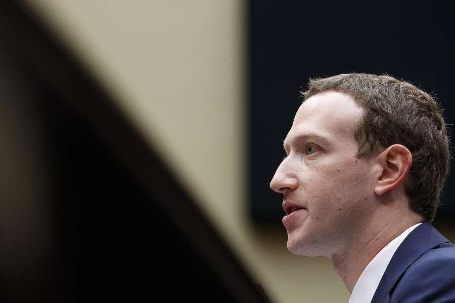"""Facebook CEO Mark Zuckerberg spend Monday and Tuesday trying to convince skeptical lawmakers that Facebook users have """"complete control"""" over what information they share. Photo: Tom Brenner / New York Times"""