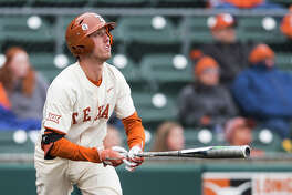Texas' Kody Clemens (2) watches his home run against Baylor during an NCAA college baseball game in Austin, Texas, Saturday, April 7, 2018. (Nick Wagner/Austin American-Statesman via AP)