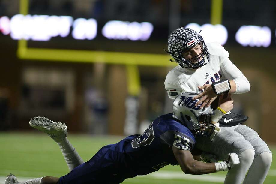 West Orange-Stark's Kayven Cooper tackles Wimberley quarterback JoJo Weeks in the Class 4A Division 2 state semifinal game at Legacy Stadium in Katy on Friday night.  Photo taken Friday 12/15/17 Ryan Pelham/The Enterprise Photo: Ryan Pelham / Ryan Pelham/The Enterprise / ©2017 The Beaumont Enterprise/Ryan Pelham