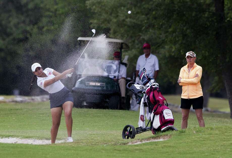 Gurleen Kaur of Cy Woods hits out of a bunker toward 18th green during the final round of the 2017 6A girls UIL State Golf Championships at Legacy Hills Golf Club in Georgetown. Photo: Jason Fochtman, Staff Photographer / Houston Chronicle / © 2017 Houston Chronicle
