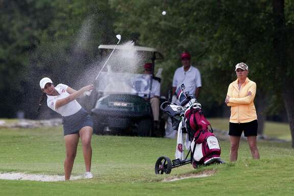 Gurleen Kaur of Cy Woods hits out of a bunker toward 18th green during the final round of the 2017 6A girls UIL State Golf Championships at Legacy Hills Golf Club in Georgetown.