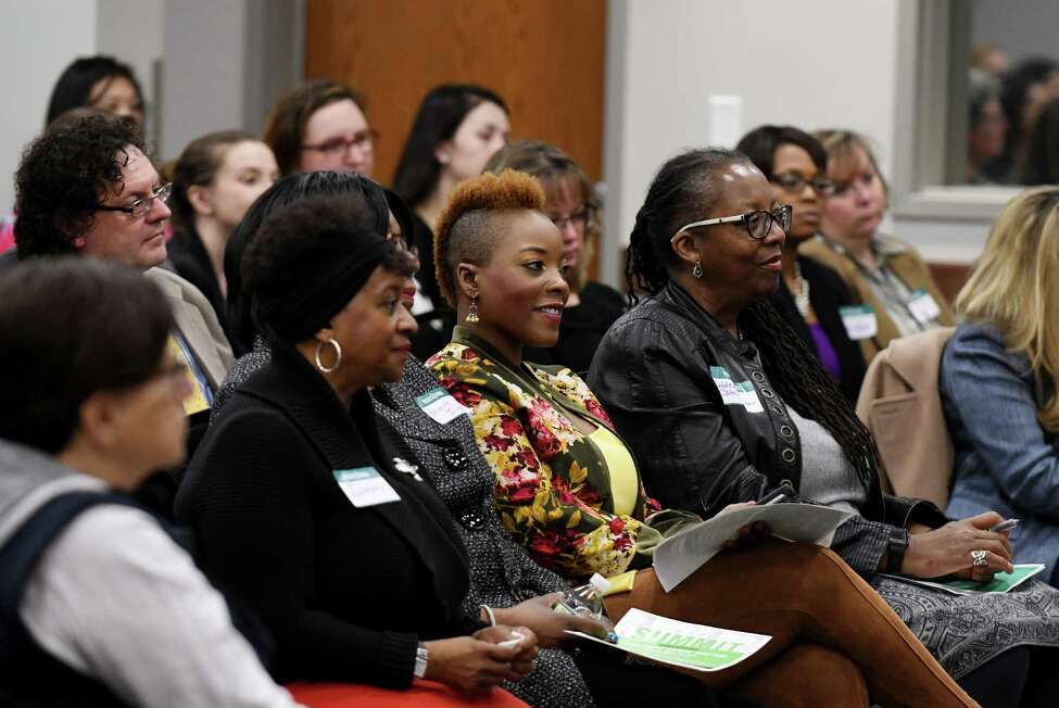 Audience members, including Daquetta Jones, executive director at YWCA of the Greater Capital Region, center, listen to Albany Common Council member Dorcey Applyrs speak during a Women@Work Changemakers breakfast event, presented by Bank of America, on Wednesday, April 11, 2018, at the Hearst Media Center in Colonie N.Y. (Will Waldron/Times Union)