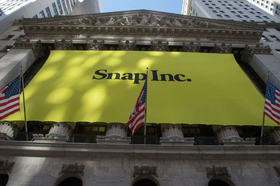 (FILES) This file photo taken on March 2, 2017 shows a Snap Inc. banner covering the facade of the New York Stock Exchange in New York. Snapchat parent Snap Inc. disclosed on November 8, 2017 that Chinese tech giant Tencent had taken a 12 percent stake, in a sign of confidence in the social network which has delivered disappointing results since its share offering this year.A securities filing showed Tencent Holdings had purchased some 146 million shares of Snap non-voting stock in open market purchases in November. / AFP PHOTO / Bryan R. SmithBRYAN R. SMITH/AFP/Getty Images Photo: BRYAN R. SMITH / AFP or licensors