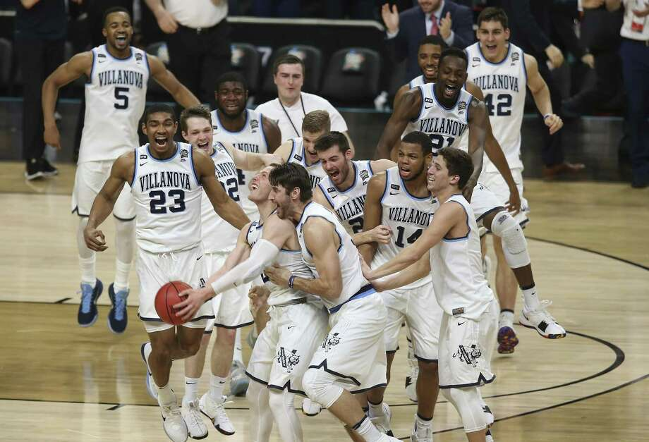 Villanova Wildcats celebrate their victory after defeating the Michigan Wolverines in the NCAA Division I Men's Basketball National Championship game at the Alamodome, Monday, April 2, 2018. Photo: JERRY LARA / San Antonio Express-News / San Antonio Express-News
