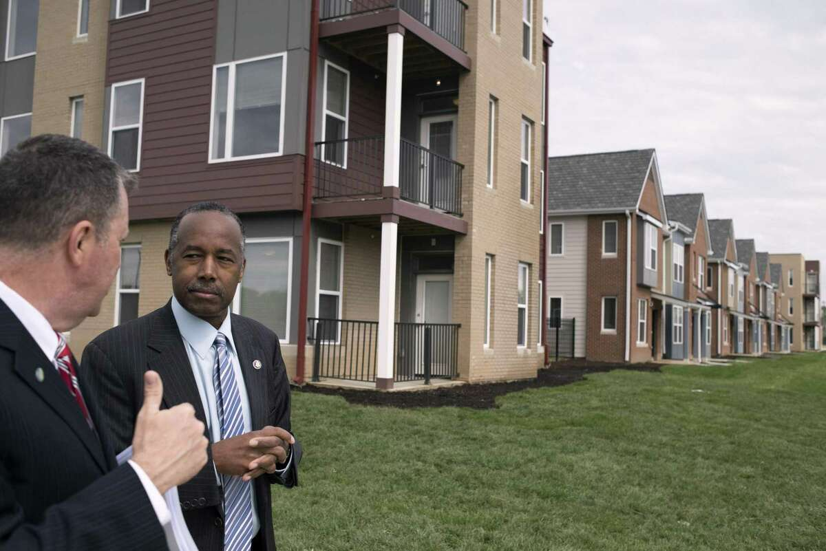 Housing and Urban Development Secretary Ben Carson tours the Columbus Choice Neighborhood in Columbus, Ohio, last year. The Trump administration is trying to scale back federal efforts to enforce fair housing laws, prompting pushback.