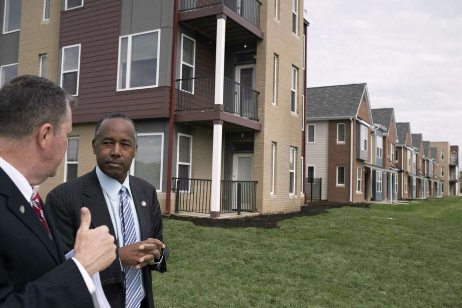 Housing and Urban Development Secretary Ben Carson tours the Columbus Choice Neighborhood in Columbus, Ohio, last year. The Trump administration is trying to scale back federal efforts to enforce fair housing laws, prompting pushback. Photo: Ty Wright /New York Times / NYTNS