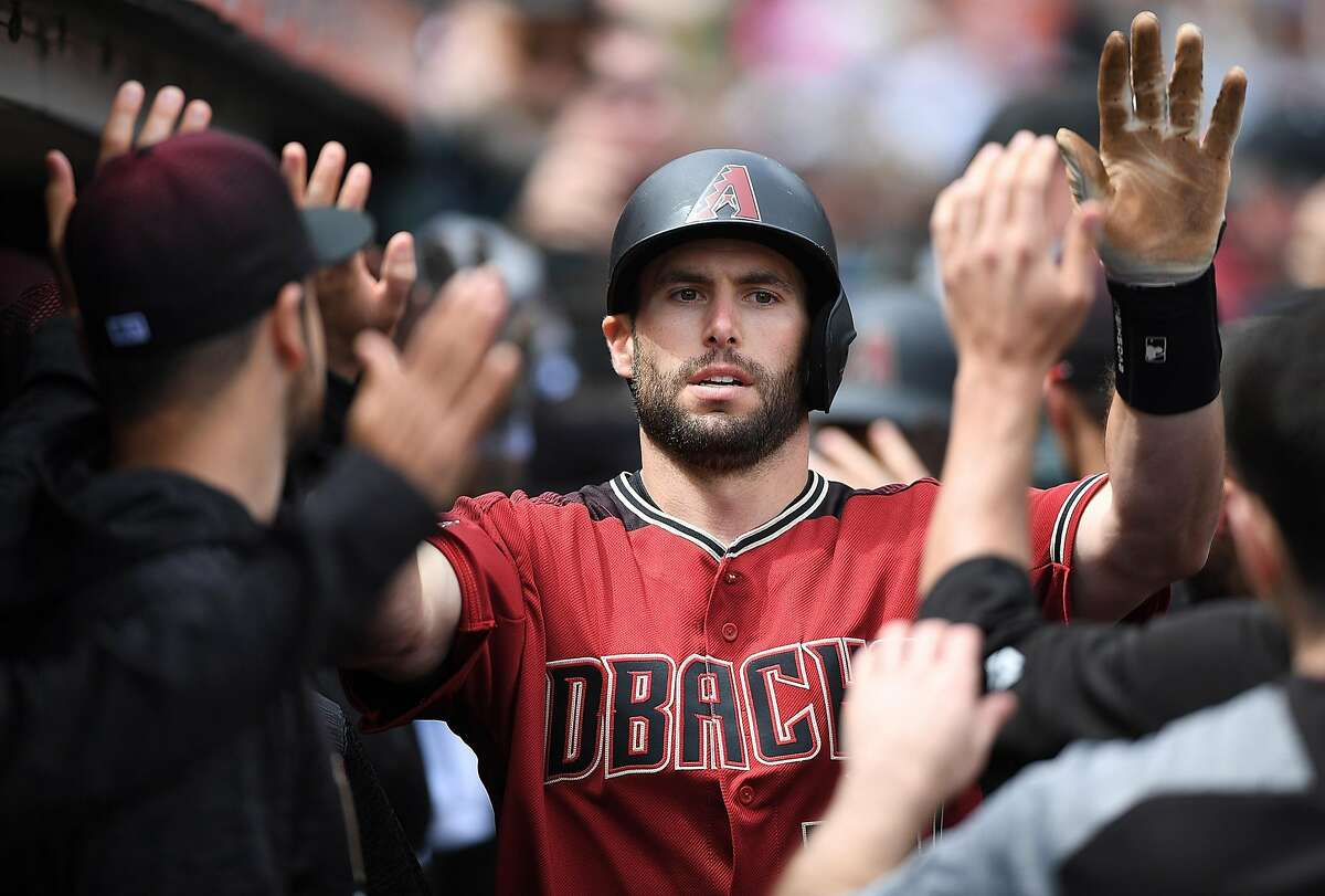 SAN FRANCISCO, CA - APRIL 11: Paul Goldschmidt #44 of the Arizona Diamondbacks is congratulated by teammates in the dugout after he hit a two-run homer against the San Francisco Giants in the top of the fourth inning at AT&T Park on April 11, 2018 in San Francisco, California. (Photo by Thearon W. Henderson/Getty Images)