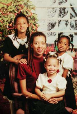 Megan Hogg, shown in an undated photo provided by her attorney, is pictured with her three girls Alexandra Hogg, 2, center,  Angelique Roberts, 3, right, and Antoinette Marden, 7. Hogg,  accused of binding her three daughters' hands with duct tape, sealing their noses and mouths and then suffocating them was charged with murder Wednesday, March, 25, 1998, at the San Mateo County Municipal Court in Redwood City, Calif. (AP Photo/Aaron Suozzi)  ALSO RAN: 4/2/98