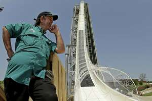 Schlitterbahn co-owner Jeffrey Henry looks over the Verruckt waterslide at the company's park in Kansas in this 2014 photo. A lender for the park project warned this week that the criminal indictments of the park and Henry in connection with the 2016 decapitation of a 10-year-old could jeopardize the repayment of $174 million in loans. Henry is charged with second-degree murder, among other charges.