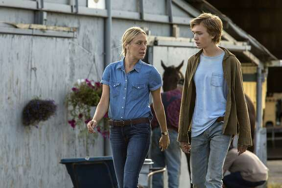 """This image released by A24 films shows Chloe Sevigny, left, and Charlie Plummer in a scene from the film, """"Lean on Pete."""" (Scott Patrick Green/A24 via AP)"""