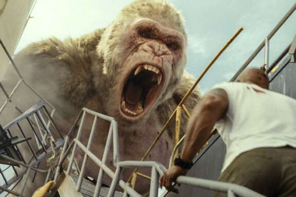"George the gorilla grows into a big problem in ""Rampage."""