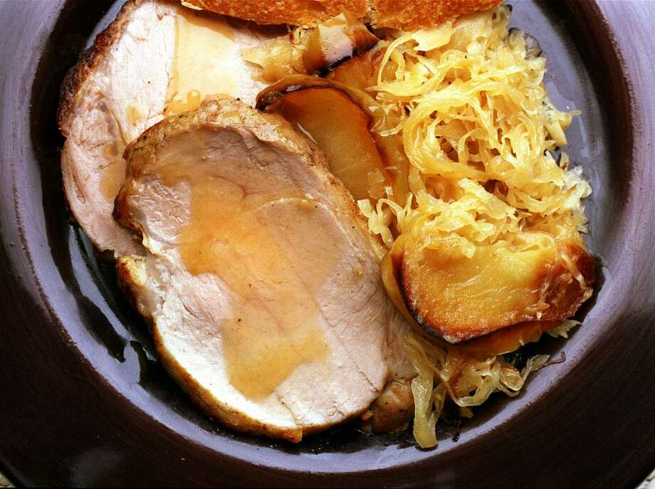 Pork and sauerkraut is rooted in Pennsylvania Dutch tradition and served up on New Year?s Day with the promise of guaranteeing good luck. (Photo by Jerry Telfer / Styling by Ethel Brennan) Photo: JERRY TELFER / CHRONICLE