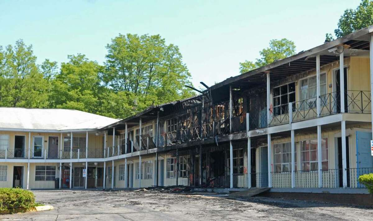 Fire Monday heavily damaged several rooms at the Governors Inn & Suites in Guilderland. (Paul Buckowski / Times Union)