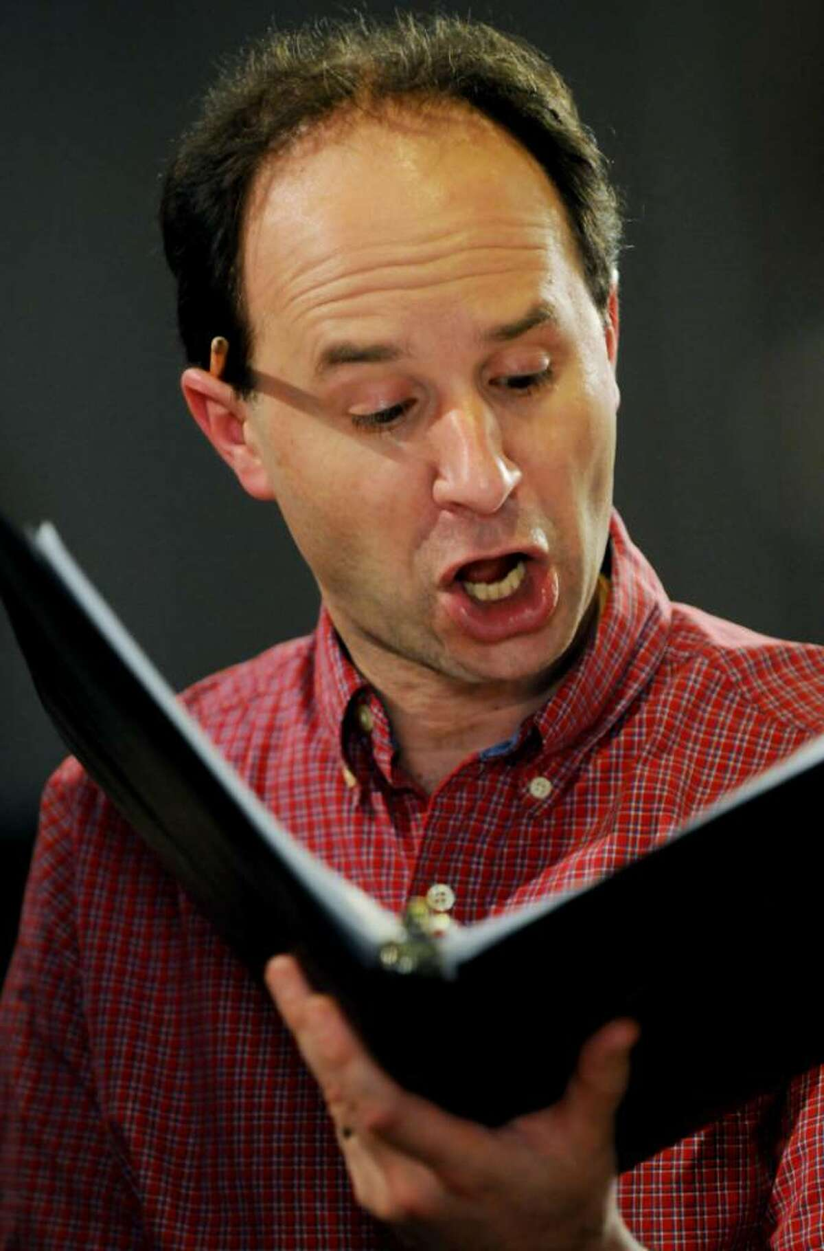 John Schreiner of Schenectady, a singer in the Aoede Consort, rehearses at St. Patrick's Roman Catholic Church in Watervliet on Monday, June 7, 2010. (Luanne M. Ferris / Times Union)