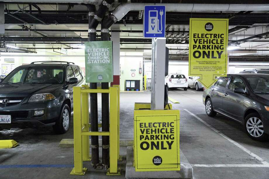An electric vehicle charging station is located in a parking garage in Santa Monica, Calif. Photo: MONICA ALMEIDA, STF / New York Times / NYTNS