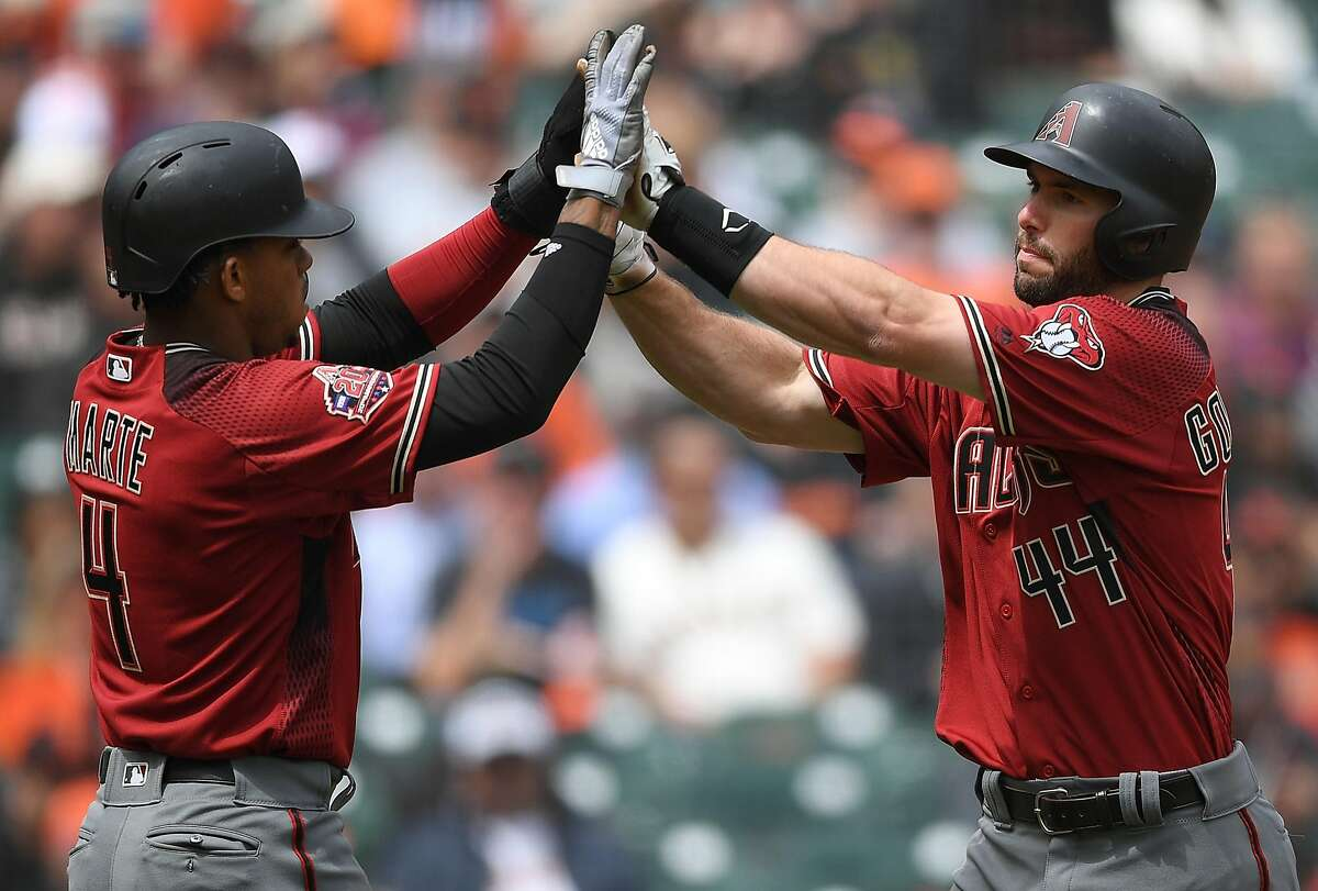 SAN FRANCISCO, CA - APRIL 11: Paul Goldschmidt #44 of the Arizona Diamondbacks is congratulated by Ketel Marte #4 after Goldschmidt hit a two-run homer against the San Francisco Giants in the top of the fourth inning at AT&T Park on April 11, 2018 in San Francisco, California. (Photo by Thearon W. Henderson/Getty Images)