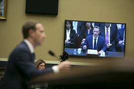 Seen from a large television screen, Mark Zuckerberg, chief executive of Facebook, testifies before the  House Energy and Commerce Committee on Capitol Hill, in Washington, April 11, 2018. Zuckerberg faced a second day of congressional testimony Wednesday over his company's handling of user data. (Lawrence Jackson/The New York Times)
