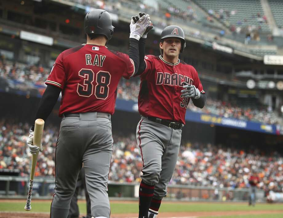 Arizona Diamondbacks' John Ryan Murphy, right, is congratulated by Robbie Ray (38) after hitting a home run off San Francisco Giants' Andrew Suarez in the fifth inning of a baseball game Wednesday, April 11, 2018, in San Francisco. Photo: Ben Margot / Associated Press
