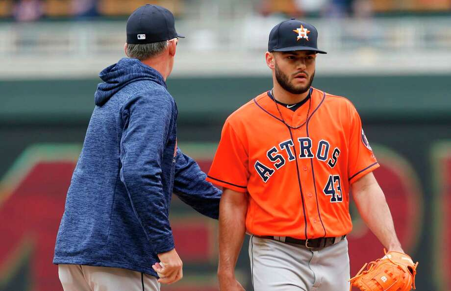 Houston Astros pitcher Lance McCullers Jr., right, gets a pat on the back from manager Al Hinch as he is pulled in the fourth inning of a baseball game after giving up a two-run home run to Minnesota Twins' Max Kepler Wednesday, April 11, 2018, in Minneapolis. (AP Photo/Jim Mone) Photo: Jim Mone, STF / Copyright 2018 The Associated Press. All rights reserved.