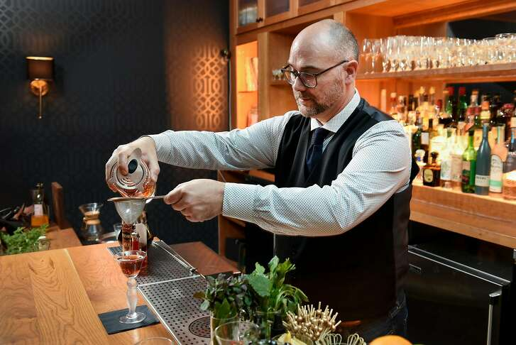 """General manager Ron Boyd mixes up an """"In a Nutshell"""" cocktail in the Linden Room at Nightbird restaurant in San Francisco, Calif., Friday March 30, 2018."""