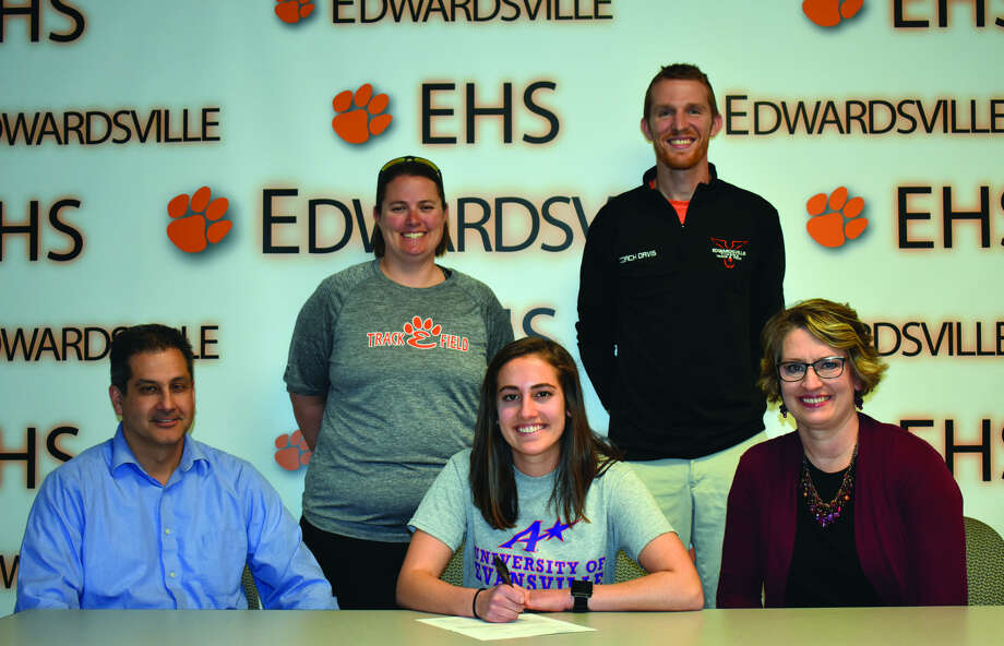 Pictured is EHS senior Katelyn Singh, center, with parents Dave and Ellen. Standing are EHS coaches Camilla Eberlin, left, and Dustin Davis.