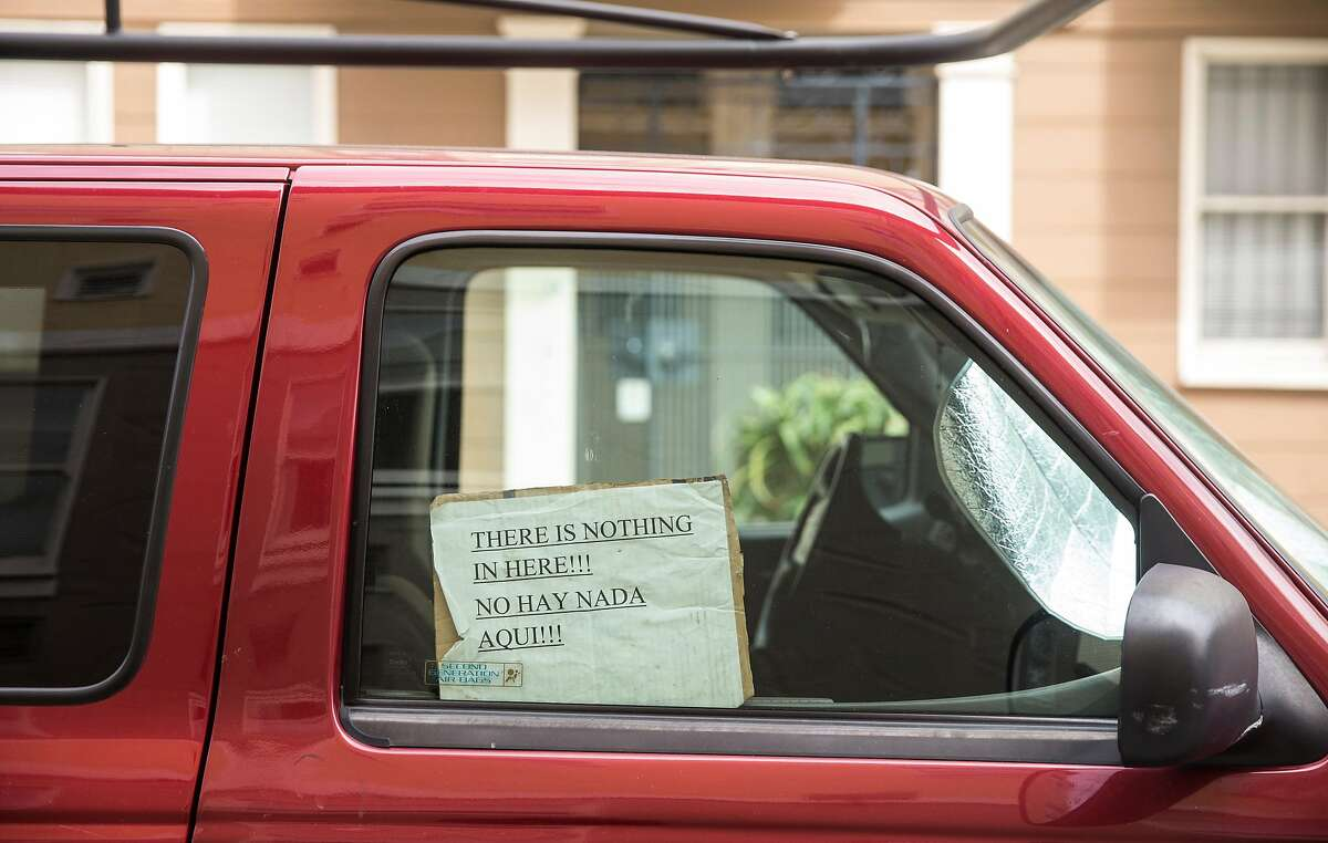 A note pleading for burglars not to break in is seen in the passenger's window of a truck parked near Dolores Park at 18th and Lexington streets Wednesday, April 11, 2018 in San Francisco, Calif.