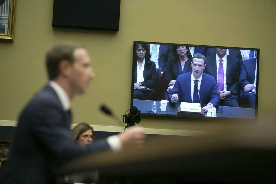 Seen from a large television screen, Mark Zuckerberg, chief executive of Facebook, testifies Wednesday before the House Energy and Commerce Committee on Capitol Hill, in Washington. Zuckerberg faced a second day of congressional testimony over his company's handling of user data. Photo: LAWRENCE JACKSON, STR / NYT / NYTNS