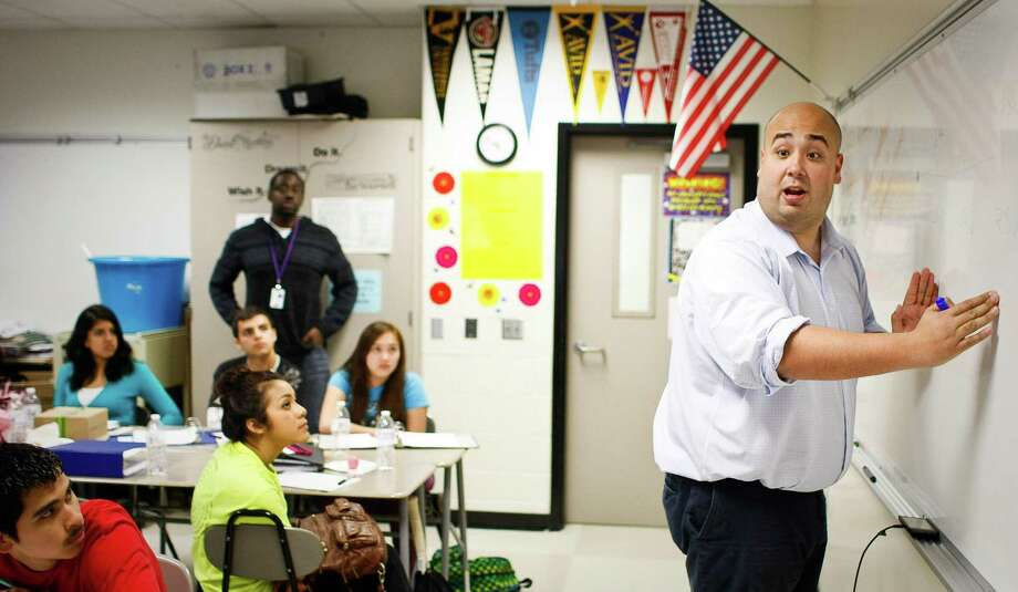 Rick Cruz talks about how students at a university typically score on tests and what numbers to shoot for during an EMERGE meeting at Chavez High School. Emerge meetings help high school students with preparing to get in and graduate from college. Photo: Nick De La Torre, Staff / Chronicle / © 2013 Houston Chronicle